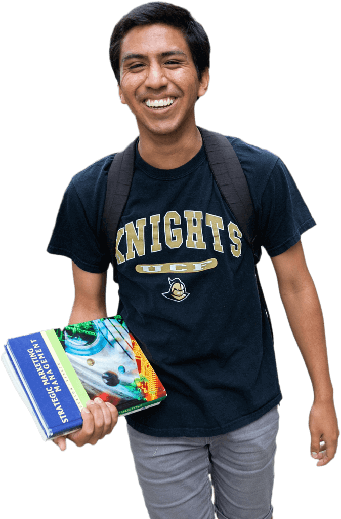 Male student holding textbooks