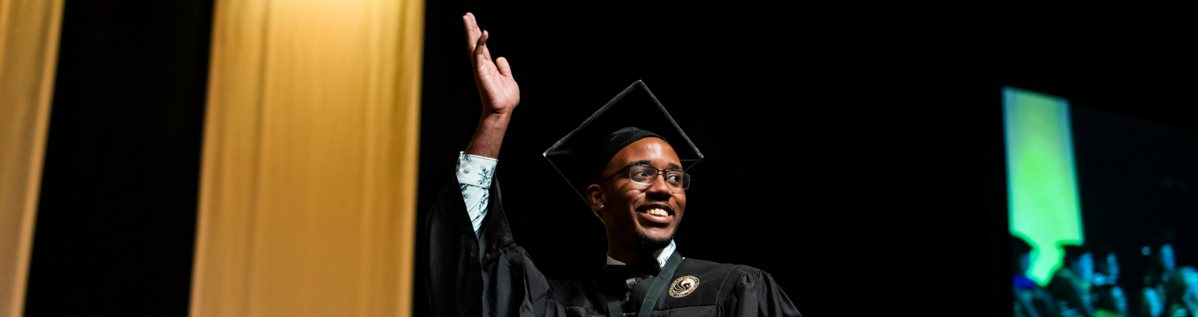 Graduate at Commencement